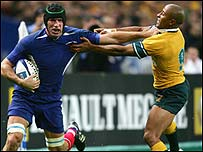 France's Olivier Magne (left) fends off Australia captain George Gregan