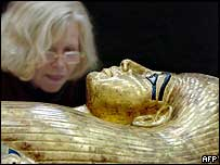 A museum visitor looks at one of the coffins found with Tutankhamun's mummy