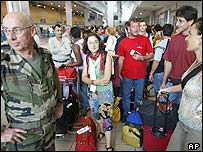 French citizens wait to depart to France at Abidjan airport