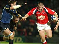 Scarlets prop Phil John takes on the Leinster defence