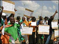 Anti-French protesters demonstrate as African Union leaders arrive for their summit in Abuja, Nigeria