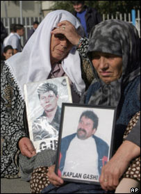 Kosovo Albanian women hold portraits of relatives missing since the 1999 war