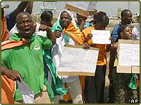 Anti-French protestors gather as African leaders arrive at Abuja international airport in Nigeria