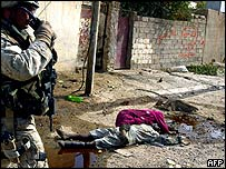 Bodies near a US marine in Falluja