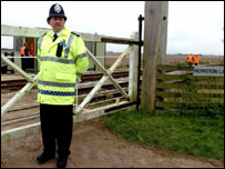 Policeman at level crossing