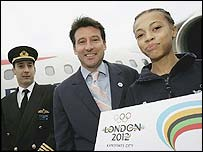 Bid leader Seb Coe (centre) and 14-year-old Amber Charles (right) prepare to board the plane at London City airport with the 600-page document