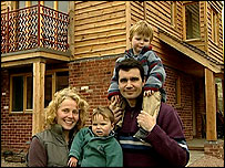 The King family outside their home in the Wintles development