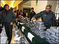 Police display the drugs haul in Lima