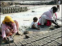 Pakistani women making bricks