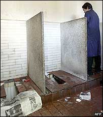A Chinese man uses a public toilet in Beijing (17/11/04)