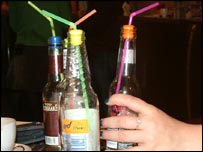 Bottles with spike stoppers fitted