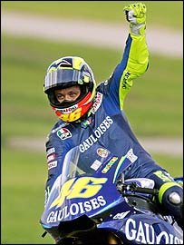 Valentino Rossi celebrates on his Yamaha