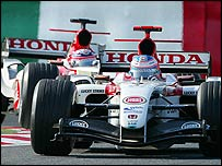Jenson Button leads BAR-Honda team-mate Takuma Sato at the 2004 Japanese Grand Prix