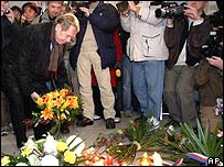 Vaclav Havel places flowers at the 1989 Velvet Revolution Memorial place at Narodni Trida in Prague