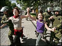 Protesters in Santiago are detained by police
