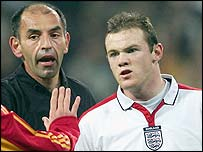 Wayne Rooney confronts Michel Salgado during England's defeat