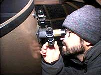 John Napper looking through his telescope in his home-observatory
