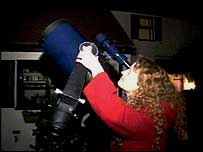 Deborah Hambly stargazing with her telescope