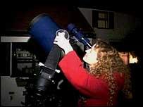 Deborah Hambly stargazing with her telescope