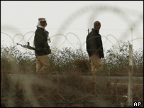 Egyptian soldiers patrol on the border between Egypt and Israel