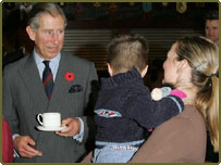 Prince Charles with a mother and her son