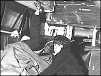 A casualty in an ambulance after the Birmingham pub bombings