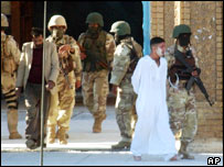 Iraqi troops lead men away from Abu Hanifa mosque