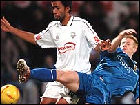 Preston goalscorer Youl Mawene tangles with Cardiff's Paul Parry