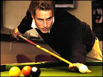 Prince William playing pool at a bar at St Andew's