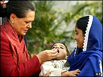 Congerss Party leader Sonia Gandhi gives the polio vaccine to a child in Delhi