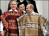 President Bush, left, Thailand's Prime Minister Thaksin Shinawatra, centre, and Russian President Vladimir Putin wear Chilean ponchos for the official Apec leaders photo