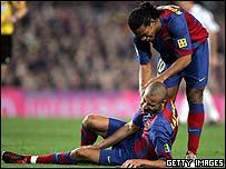 Ronaldinho comforts Henrik Larsson as the Swede lies injured