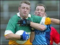 Davitt McElroy of Carrickmore battles with Mayobridge's Eoghan Woods