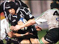 Ospreys centre Elvis Seveali'i is caught by Connacht's Ray Hogan and Christian Short