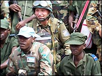 Uruguyan, south African, and Congolese soldiers working together