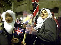 Muslim girls with British flags