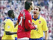 Ruud van Nistelrooy and Martin Keown (right)