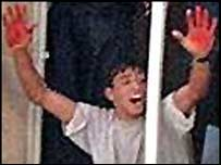 Aziz Salha holds up bloody hands as two Israeli soldiers are killed in Ramallah, October 2000