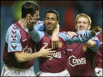 Aston Villa celebrate Nolberto Solano's winning strike