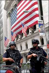 Police officers on guard in front of the New York Stock Exchange building in August 2004