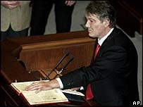 Ukraine's opposition leader Viktor Yushchenko takes a symbolic oath of office