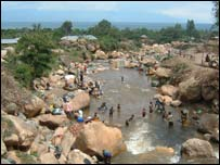 People in Uvira bathing in the river