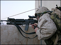 Marine peers through machinegun scope during Falluja assault - photo Robbie Wright