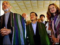 Afghanistan's President Hamid Karzai with the three freed UN workers