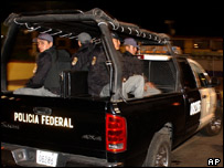 Police patrol Mexico City suburb where mob murder two officers