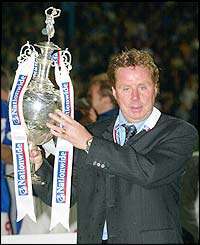 Harry Redknapp holds the Division One trophy aloft