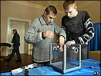 Ukrainian election officials install a ballot box in Lviv, western Ukraine