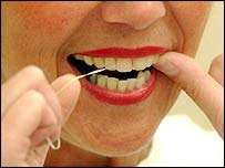 Image of a woman flossing