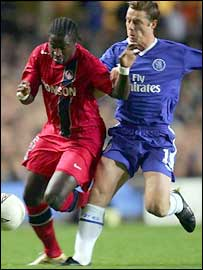 Scott Parker (right) tangles with Bernard Mendy