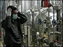 Iranian worker adjusts his hat at Iran's Isfahan nuclear facility